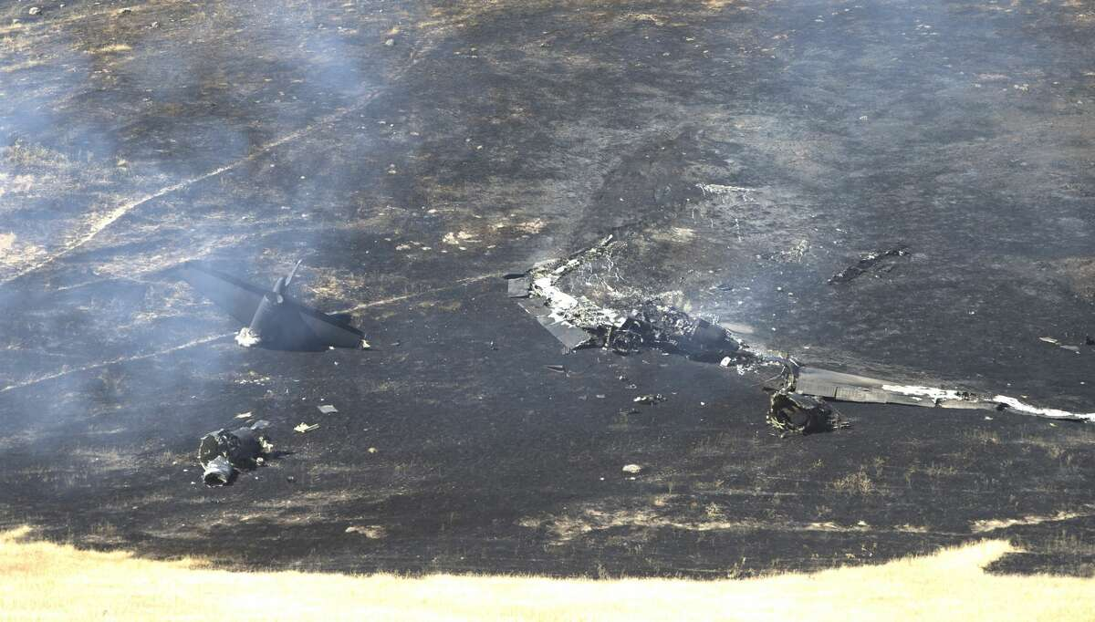Smoke rises from the wreckage of a U.S. Air Force U-2 spy plane that crashed in the Sutter Butte mountains, Tuesday, Sept. 20, 2016, near Yuba City, Calif. The plane had just taken off on a training mission from nearby Beale Air Force Base. The two pilots ejected before the crash. (AP Photo/Rich Pedroncelli)