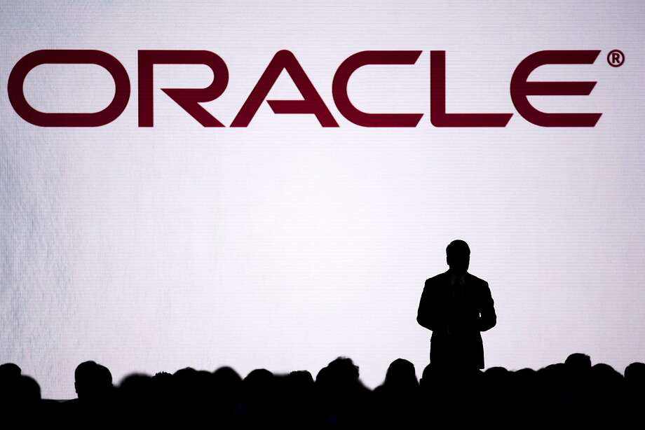 The silhouette of Thomas Kurian, president of product development at Oracle Corp., is seen on stage during the Oracle OpenWorld 2016 conference in San Francisco, California, U.S., on Tuesday, Sept. 20, 2016. OpenWorld gathers leading members of the industry to provide insight into Oracle Cloud, customer success in the cloud, and the next wave of opportunity in the enterprise. Photographer: David Paul Morris/Bloomberg Photo: David Paul Morris, Bloomberg