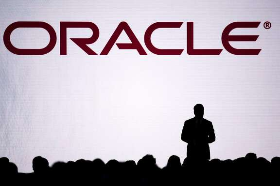 The silhouette of Thomas Kurian, president of product development at Oracle Corp., is seen on stage during the Oracle OpenWorld 2016 conference in San Francisco, California, U.S., on Tuesday, Sept. 20, 2016. OpenWorld gathers leading members of the industry to provide insight into Oracle Cloud, customer success in the cloud, and the next wave of opportunity in the enterprise. Photographer: David Paul Morris/Bloomberg