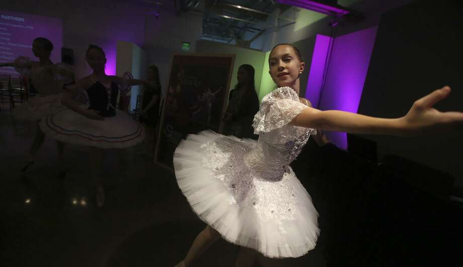 Ballerina Lucy Hassman performs Sept. 20, 2016 during the announcement of the formation of the San Antonio Tricentennial Commission. The event begins on May 1-6, 2018 and will celebrate San Antonio's 300 years of life, commemorating San Antonio's art, culture, history and presence on the gobal stage. Photo: John Davenport /San Antonio Express-News / ©San Antonio Express-News/John Davenport