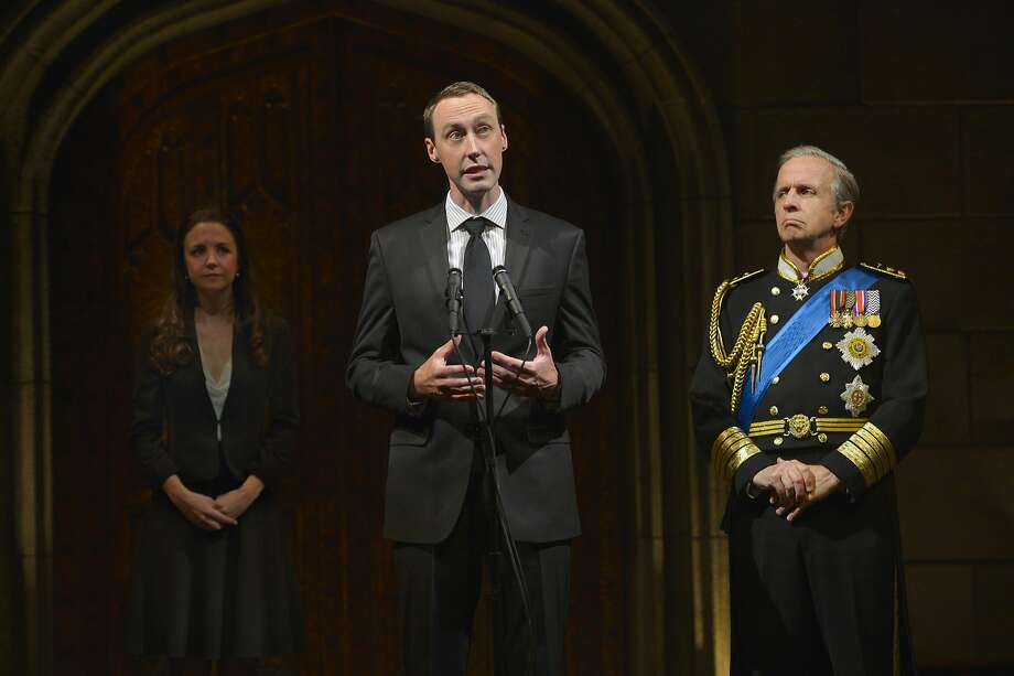 Prince William (Christopher McLinden) speaks to members of the press with Kate (Allison Jean White) and Charles (Robert Joy) by his side. Photo: Kevin Berne, American Conservatory Theater