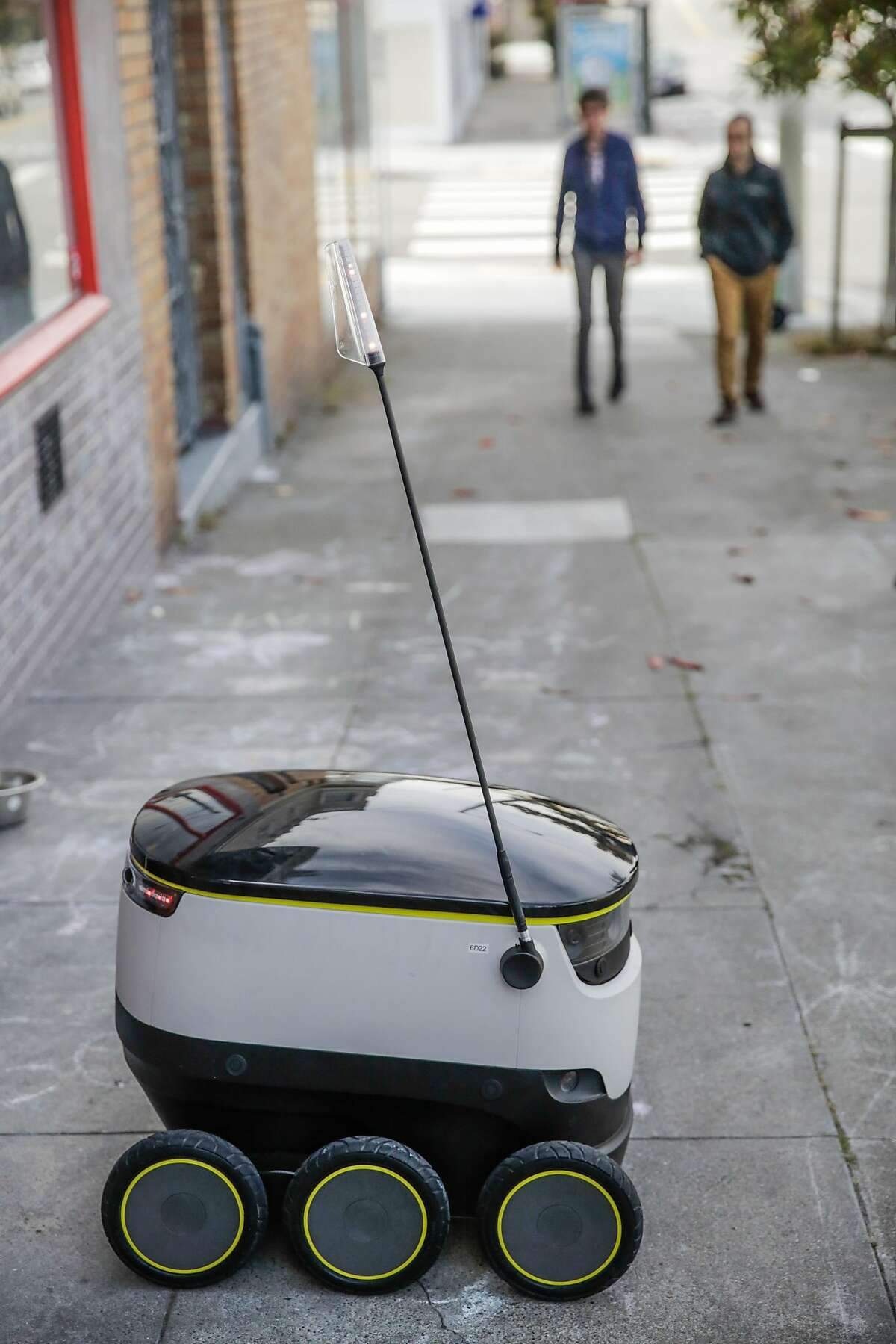 A starship delivery robot sits outside Orson's Belly cafe as it prepares to do it's first autonomous delivery, in San Francisco, California, on Tuesday, Sept. 20, 2016.