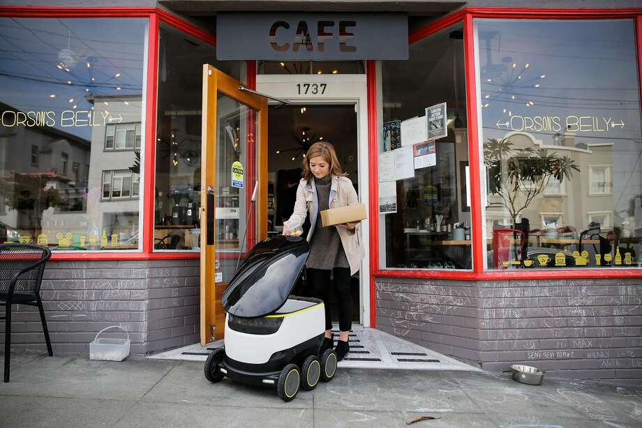 Megan Keesee, who does PR for Starship technologies demonstrates how a Starship delivery robot works as it prepares to do it's first autonomous delivery, in San Francisco, California, on Tuesday, Sept. 20, 2016. Photo: Gabrielle Lurie, Special To The Chronicle