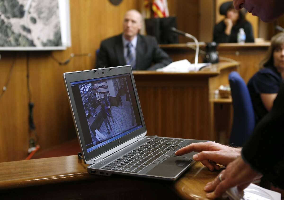 Leon Kousharian, with the district attorney's office, plays video footage from a Grants Pass, Ore. McDonald's security camera during a preliminary hearing on double homicide charges against Morrison Haze Lampley and Lila Scott Alligood in Marin County Superior Court in San Rafael, Calif. on Tuesday, Sept. 20, 2016.