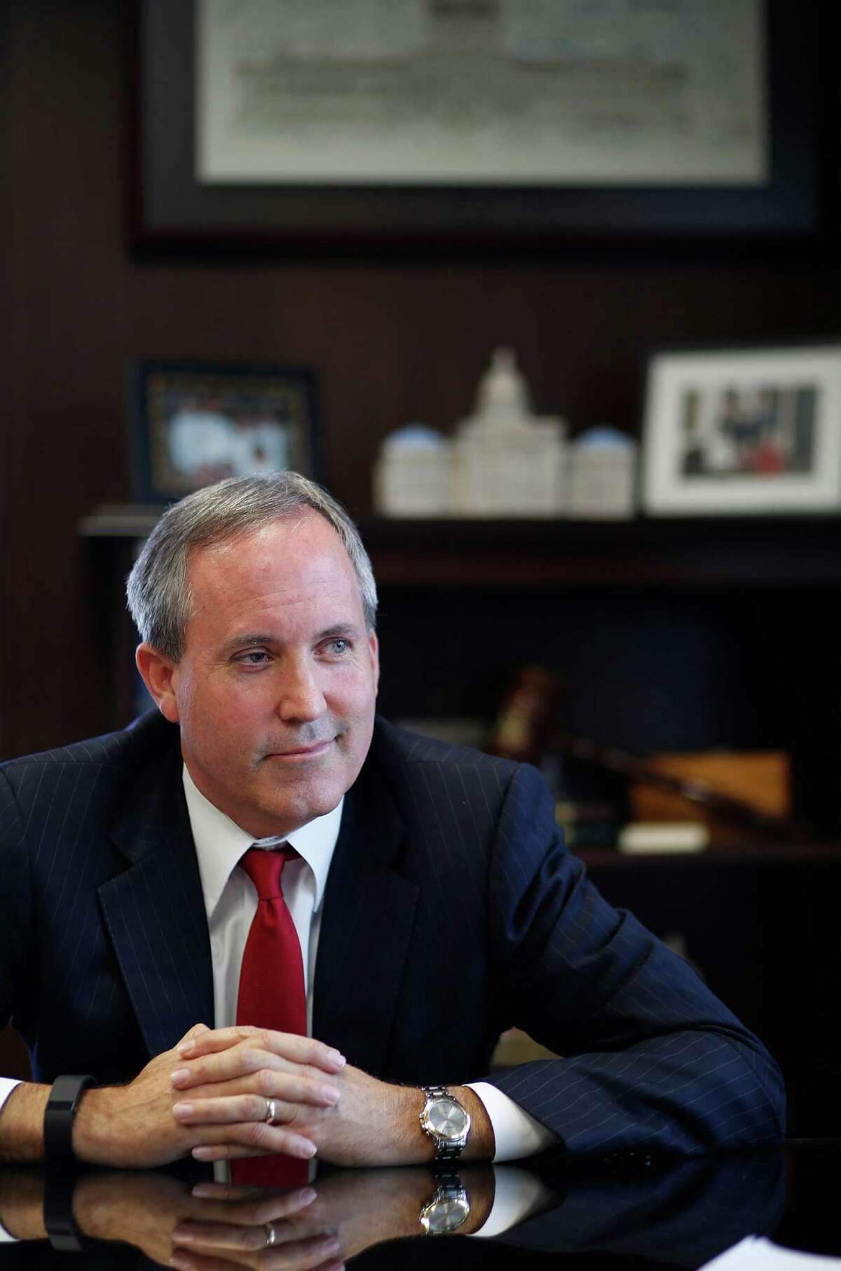 Texas Attorney General Ken Paxton is interviewed inside his Austin office. Twenty-one states including Texas sued the U.S. Department of Labor on Tuesday, seeking to stop the Obama administration's implementation of new overtime rules set to go into effect in December.