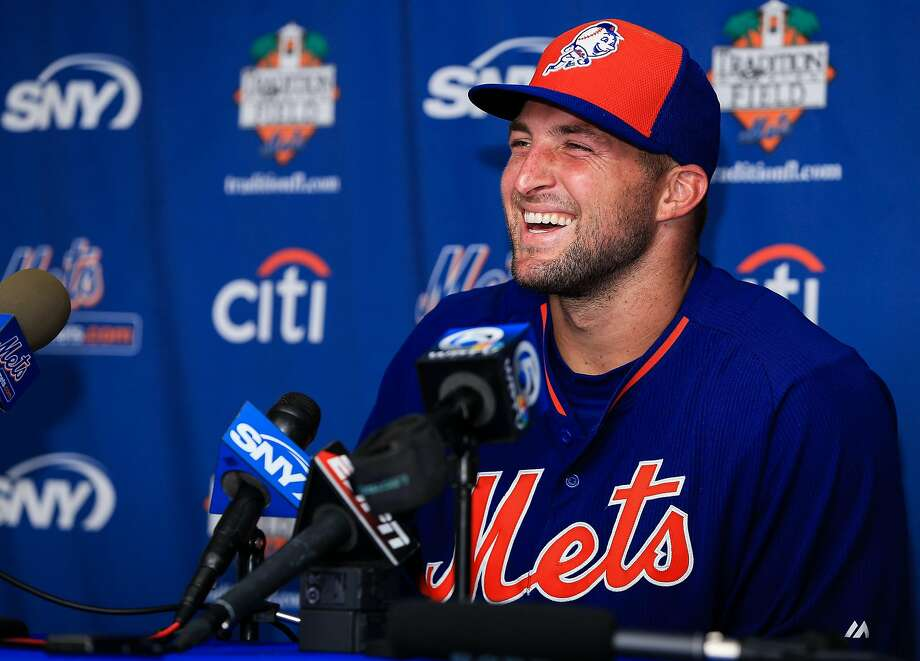 Tim Tebow speaks at a press conference Tuesday after a work out at an instructional league day at Tradition Field. Sdhoy/Getty Images) Photo: Rob Foldy, Getty Images