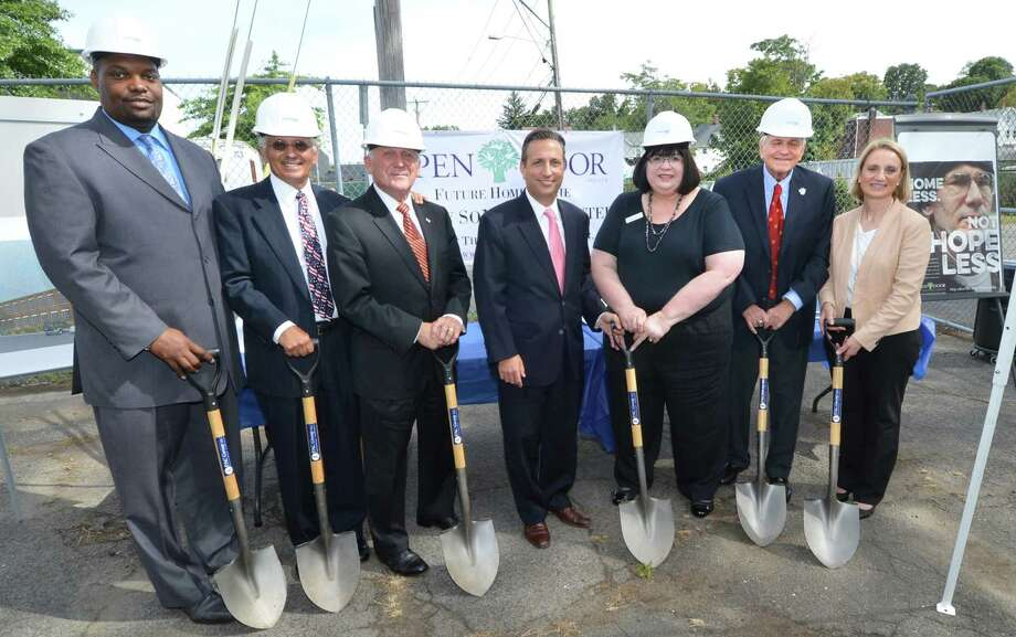 The Smilow SoNo Life Center held a Hard Hat Ceremony for the new multipurpose facility of The Open Door Shelter on 2 Merritt Place on Tuesday Sepember 20, 2016 in Norwalk Conn. Holding shovels for the ceremonial groundbreaking are Craig Glover, Norwalk Community Health Center, Corky Stewart, Board President, Open Door Shelter, Norwalk Mayor Harry Rilling, State Senate Majority Leader Bob Duff, Open Door Shelter Executive Director Jeannette Archer-Simmons, Joel Smilow, Joel E. Smilow Charitable Trust and Commissioner Evonne Klein, Department of Housing. Photo: Alex Von Kleydorff / Hearst Connecticut Media / Connecticut Post