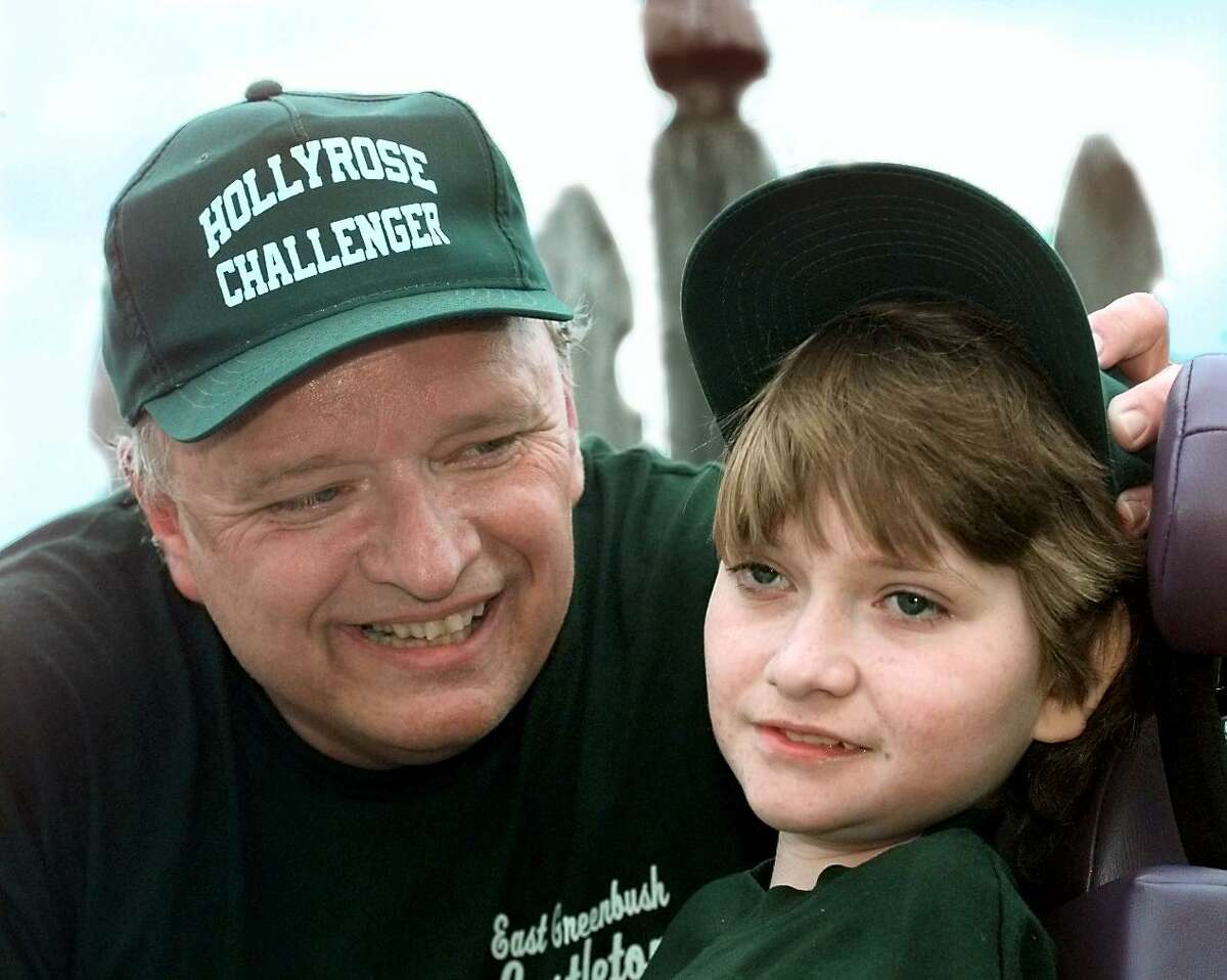 Burke Adams and his daughter, Jaime, 13, during an East Greenbush/Castleton Little League challenger division game in June 1998 in East Greenbush, N.Y. (Luanne M. Ferris/Times Union)