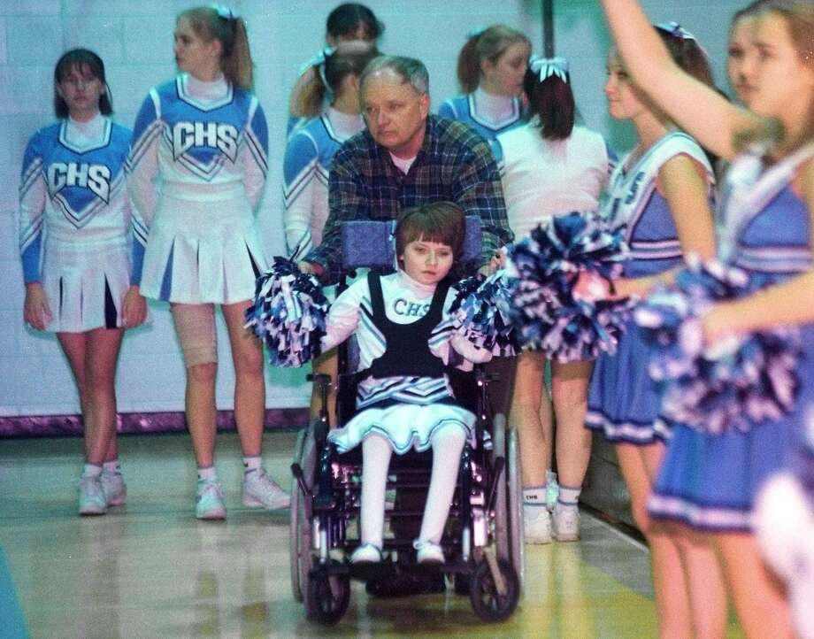 Jaime Adams, 14, cheerleader for Columbia High School, cheers on the sidelinea during a Columbia High School basketball game with her father, Burke Adams, and the rest of the Columbia cheerleaders on Jan. 30, 1999, in East Greenbush, N.Y. (James Goolsby/Times Union) Photo: JAMES GOOLSBY / ALBANY TIMES UNION
