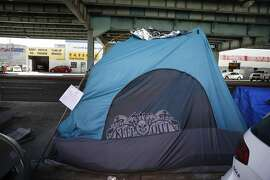 An Abatement Order to Vacate to homeless encampment tent owners is seen attached to a tent along 13th Street on Wednesday,  February 24, 2016 in San Francisco, California.