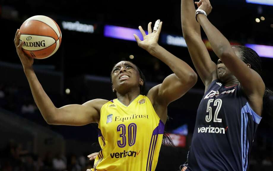 FILe - In this Sept. 8, 2016, file photo, Los Angeles Sparks forward Nneka Ogwumike, left, drives to the basket around Atlanta Dream center Elizabeth Williams during the second half of a WNBA basketball game in Los Angeles. Nneka Ogwumike has had a remarkable season for Los Angeles, putting up career numbers. That was good enough to earn her the inaugural Associated Press WNBA Player of the Year on Tuesday, Sept. 20, 2016.  (AP Photo/Chris Carlson, File) Photo: Chris Carlson, Associated Press