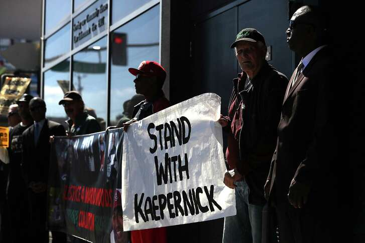Protestors demonstrate in support of San Francisco 49ers quarterback Colin Kaepernick outside of the San Francisco Police Officers Association offices on Aug. 31, 2016 in San Francisco. Kaepernick has come under fire for refusing to stand during the Star Spangled Banner in protest of what he complains is oppression of blacks and other peoples of color.  (Photo by Justin Sullivan/Getty Images)