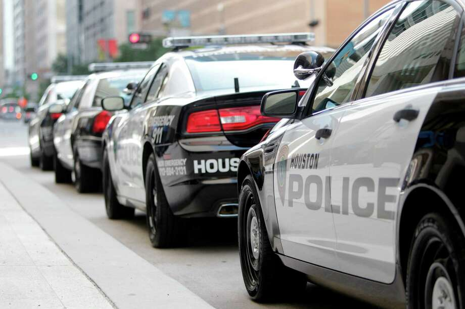Houston Police Department patrol cars parked outside HPD's downtown headquarters. Photo: Mayra Beltran, Staff / © 2012 Houston Chronicle