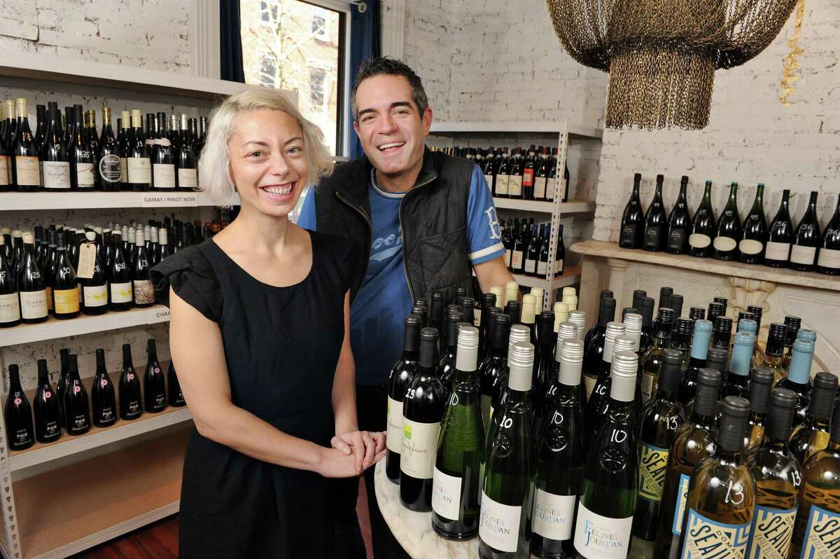 Heather LaVine with her husband, Vic Christopher at their new wine shop, 22 Second St Wine Co., Friday Nov. 20, 2015 in Troy, NY.(John Carl D'Annibale / Times Union)