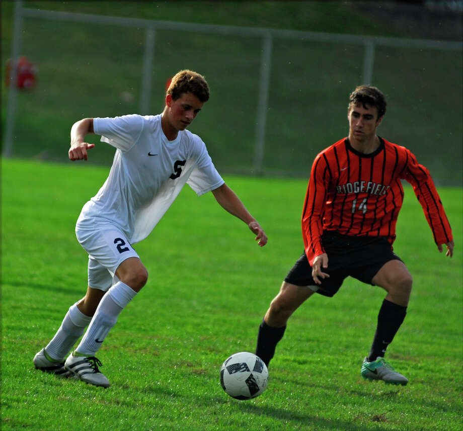 Staples' Jannis Dietze, left, and Ridgefield's Niels van Beek battle for the ball during a boys soccer game on Tuesday, September 20th, 2016. Photo: Ryan Lacey/Hearst Connecticut Media / Westport News Contributed