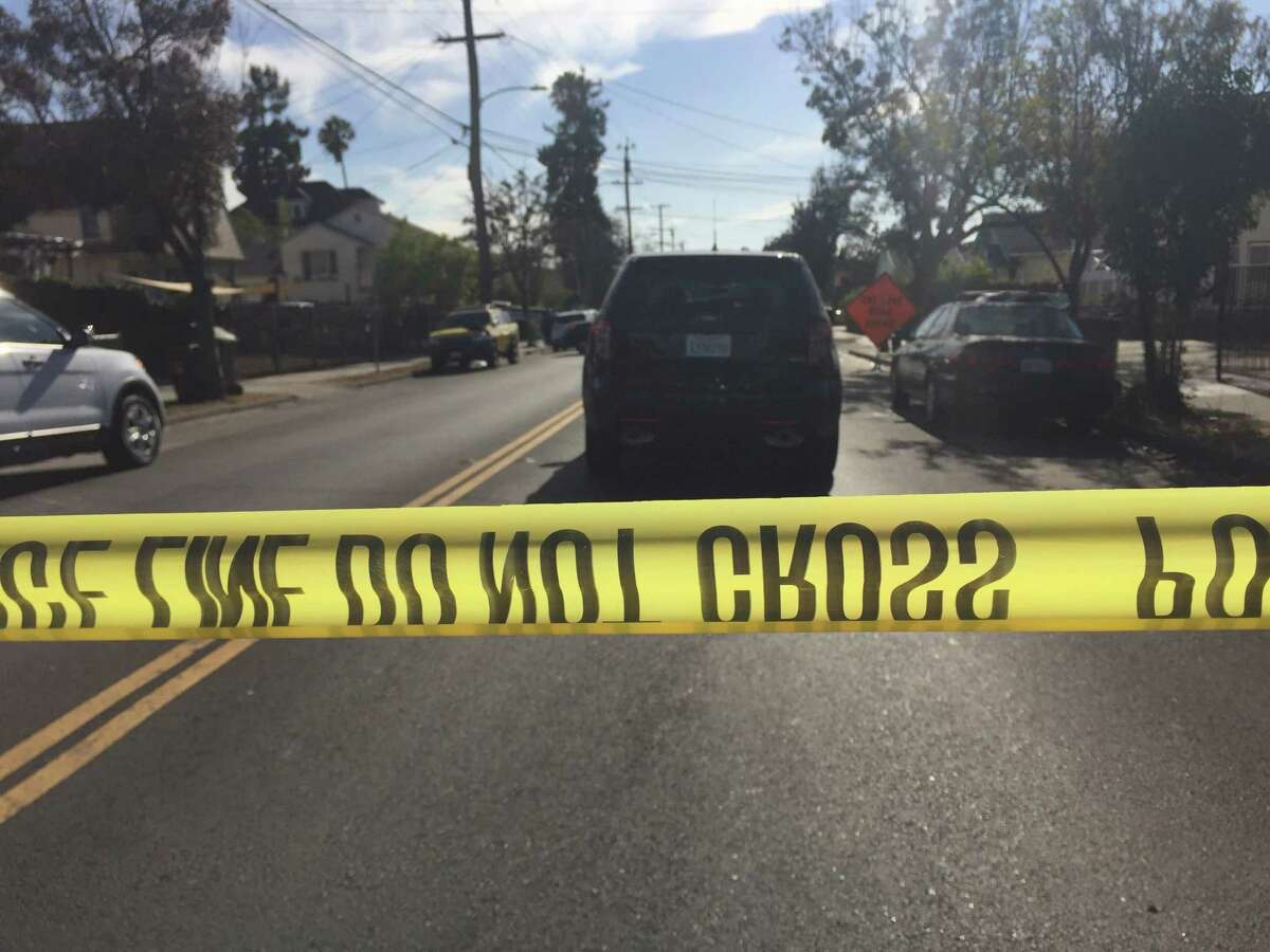 Emergency crews block off the street in Oakland's Fruitvale section where a young child was struck and killed Tuesday afternoon by a AC Transit bus after she chased a ball into the roadway.