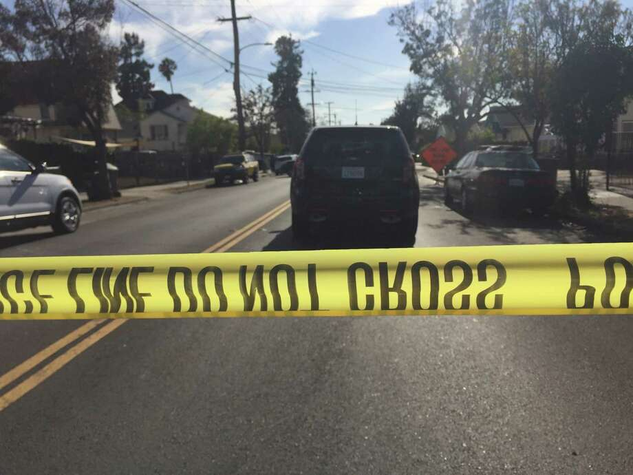 Emergency crews block off the street in Oakland's Fruitvale section where a young child was struck and killed Tuesday afternoon by a AC Transit bus after she chased a ball into the roadway. Photo: Michael Bodley / The Chronicle / /
