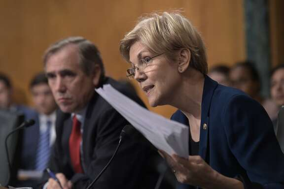 Senate Banking Committee member Sen. Elizabeth Warren, D-Mass., right, questions Wells Fargo Chief Executive Officer John Stumpf, on Capitol Hill in Washington, Tuesday, Sept. 20, 2016, during the committee's hearing. Stumpf was called before the committee for betraying customers' trust in a scandal over allegations that employees opened millions of unauthorized accounts to meet aggressive sales targets. (AP Photo/Susan Walsh)