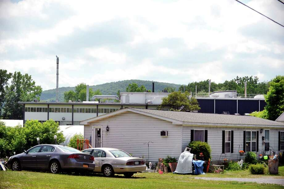 The Saint-Gobain Performance Plastics plant is seen behind homes along Carey Ave. on Tuesday, June 28, 2016, in Hoosick Falls, N.Y.    (Paul Buckowski / Times Union) Photo: PAUL BUCKOWSKI / 40037143A