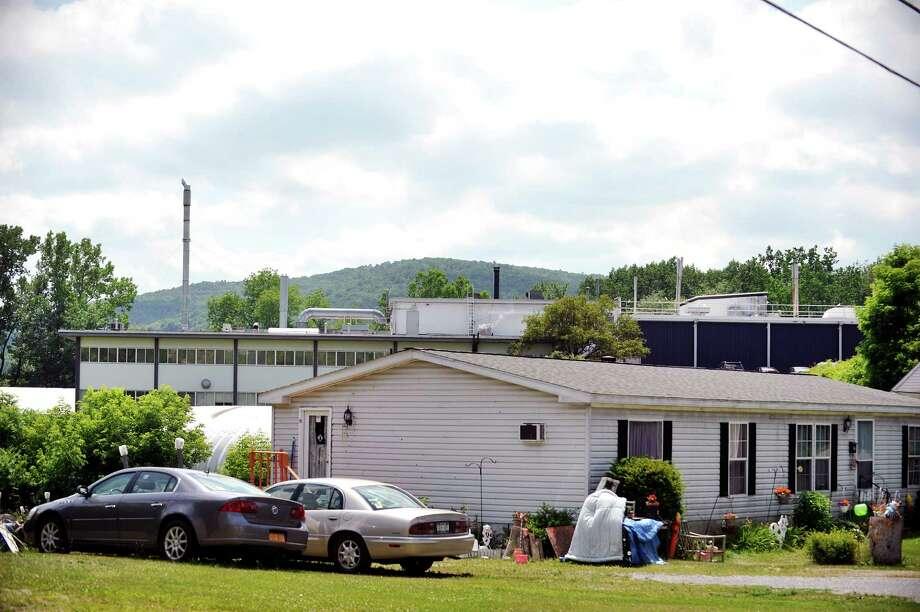 The Saint-Gobain Performance Plastics plant is seen behind homes along Carey Ave. on Tuesday, June 28, 2016, in Hoosick Falls, N.Y.    (Paul Buckowski / Times Union) Photo: PAUL BUCKOWSKI / 40037143A