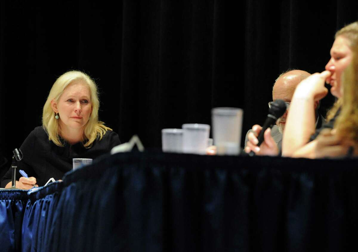 U.S. Senator Kirsten Gillibrand cries as she listens to Hoosick resident Emily Mapes tell how the PFOA contamination has personally impacted her life during a roundtable discussion at Hoosick Falls Central School on Friday July 8, 2016, in Hoosick falls, N.Y. (Michael P. Farrell/Times Union)