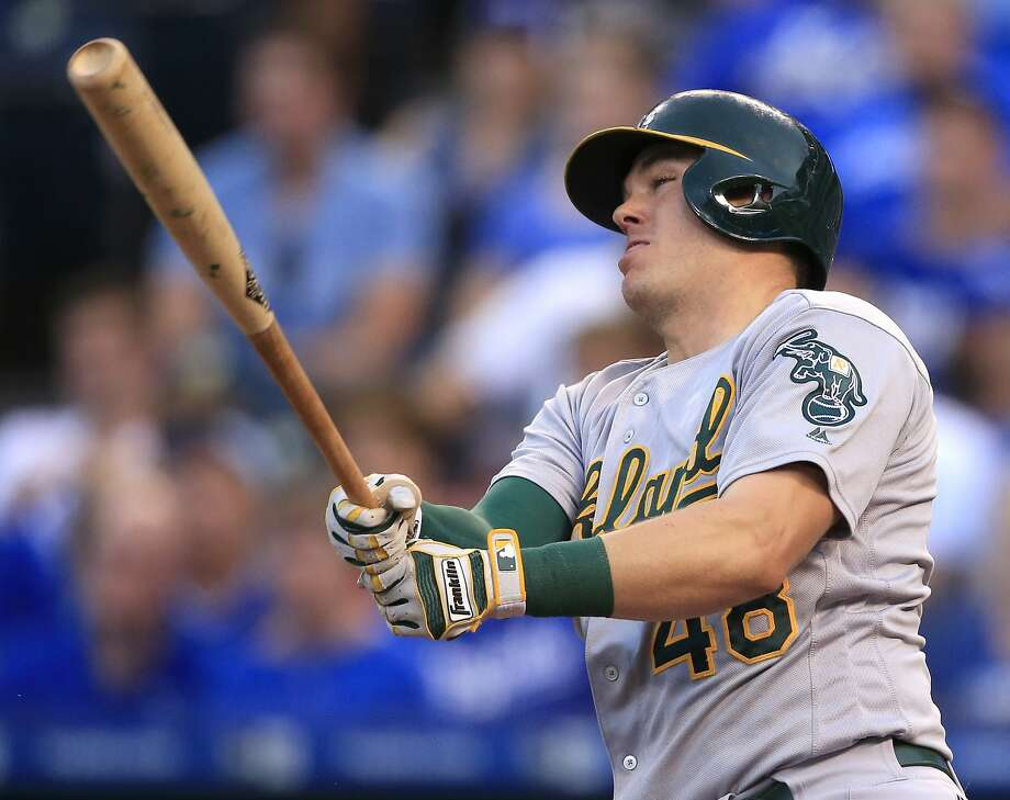 Oakland Athletics' Ryon Healy watches his three-run home run off Kansas City Royals starting pitcher Edinson Volquez during the third inning of a baseball game at Kauffman Stadium in Kansas City, Mo., Thursday, Sept. 15, 2016. (AP Photo/Orlin Wagner) Photo: Orlin Wagner, Associated Press