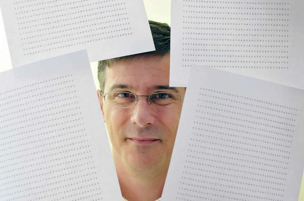 Brad Zupp poses with some sheets of numbers that he uses for training before memory competitions, seen here on Tuesday, Dec. 17, 2013 in Wilton, NY. Zupp is a memory champion who memorized 112 digits perfectly, one per second, which was a new American record. (Paul Buckowski / Times Union archive)