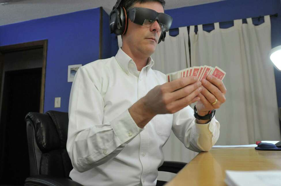 Brad Zupp goes through a deck of cards to memorize them on Tuesday, Dec. 17, 2013 in Wilton, NY. Zupp wears ear protection headphones and glasses he has taped up except for small openings to help him block out external distractions. Zupp is a memory champion who memorized 112 digits perfectly, one per second, which was a new American record. (Paul Buckowski / Times Union archive)