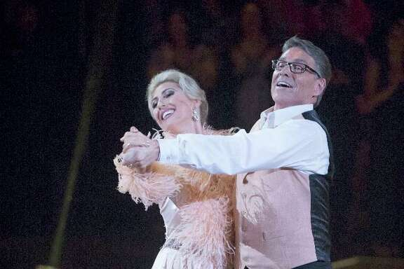 """Rick Perry and Emma Slater take a twirl on """"Dancing with the Stars."""" A reader thinks this was more honest work than joining the Trump administration."""