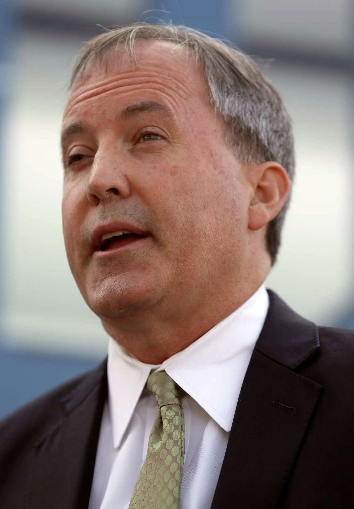 Texas Attorney General Ken Paxton talks about human trafficking during a news conference on Sept. 1 in San Antonio.