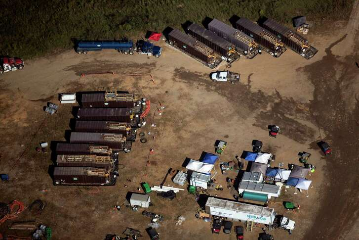 Trucks stand by as workers clean a pipeline leak Tuesday near Helena, Ala. Leaked gasoline went into a retention pond, but no fuel made it into a nearby river, the Environmental Protection Agency says.