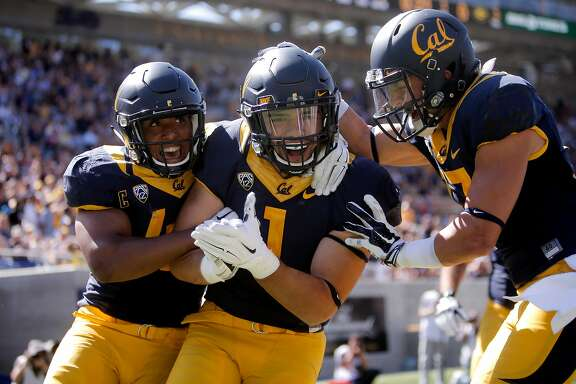 Cal's Hardy Nickerson, 47 and Luke Rubenzer, 17 celebrate the interception return for a touchdown by Devante Downs, 1 in the first quarter, as the University of California Golden Bears take on the Grambling State Tigers at Memorial Stadium on Sat. September 5, 2015, in Berkeley, Calif.