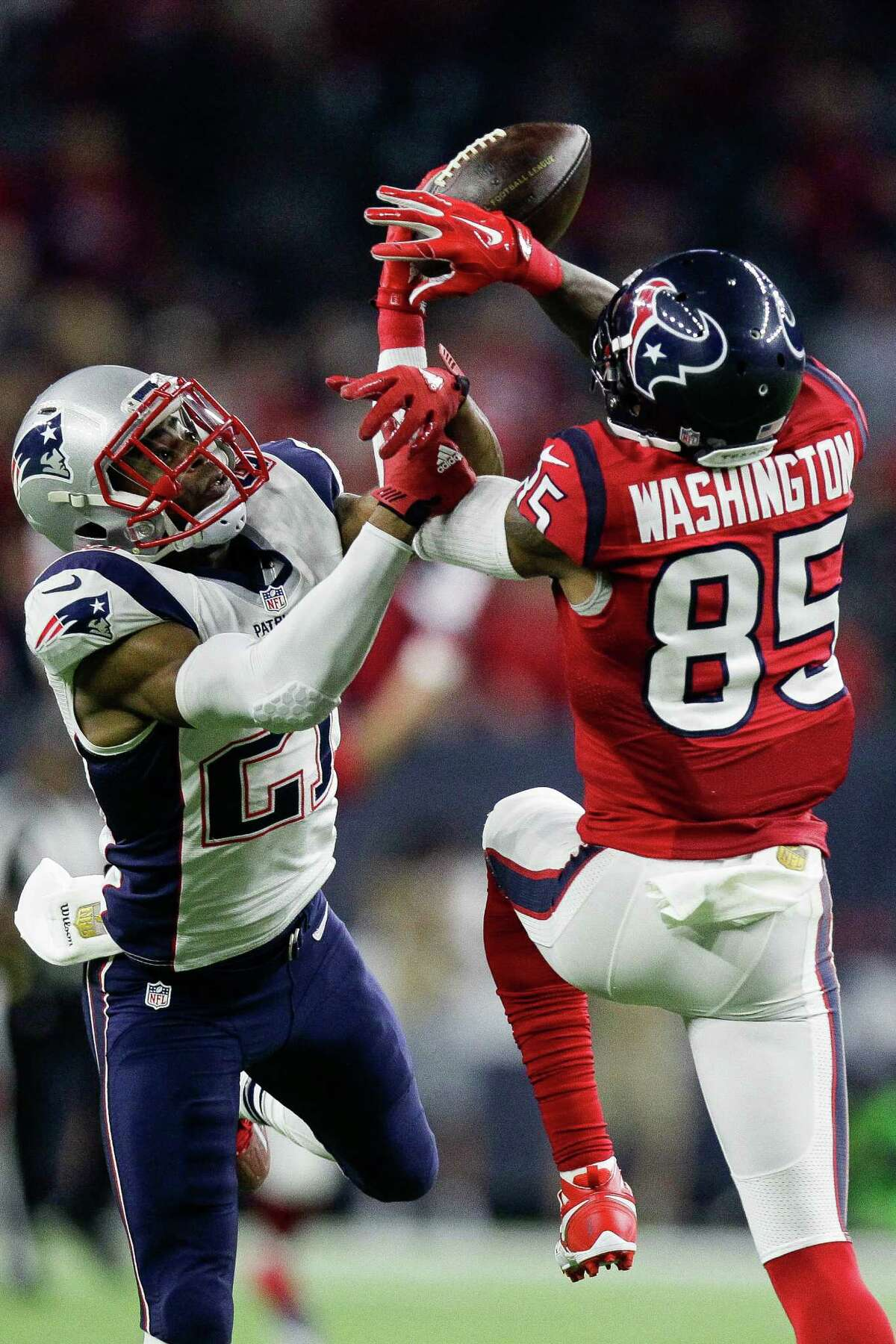 Patriots cornerback Malcolm Butler, known for a Super Bowl-deciding interception, breaks up a pass intended for Nate Washington, right, during last year's game against the Texans.