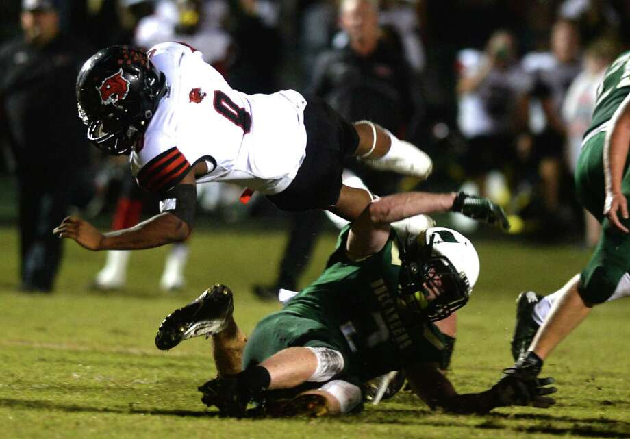 Kirbyville's Ty Dennis leaps over the Buccaneer's defense during a match up at the East Chamber's field Thursday night. Photo taken Wednesday, November, 4, 2015 Guiseppe Barranco/The Enterprise Photo: Guiseppe Barranco, Photo Editor