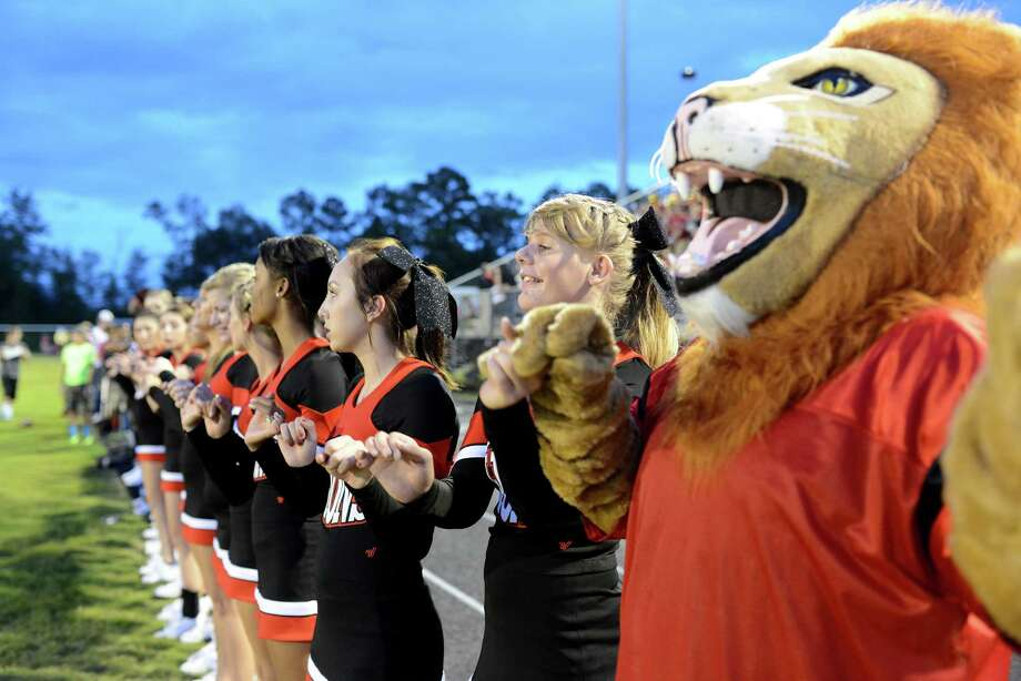 The Kountze Lions cheerleaders prepare for kickoff agaisnt the Hardin Jefferson Hawks at the Hawk Stadium Friday night. Photo by Drew Loker. Photo: Drew Loker / ©2014. www.DrewLoker.com