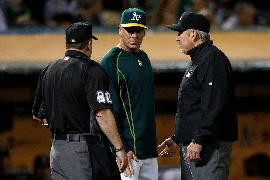 OAKLAND, CA - SEPTEMBER 20:  Bob Melvin #6 of the Oakland Athletics informs umpire Marty Foster #60 and umpire Mike Winters #33 that his team is playing under protest after an official review during the third inning against the Houston Astros at the Oakland Coliseum on September 20, 2016 in Oakland, California. (Photo by Jason O. Watson/Getty Images) Photo: Jason O. Watson, Getty Images