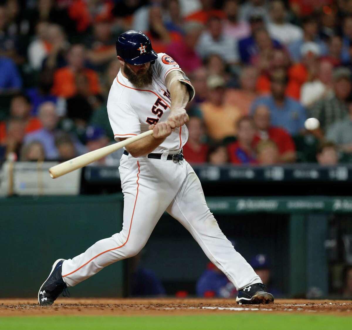 Houston Astros designated hitter Evan Gattis (11) flies out to Texas Rangers center fielder Carlos Gomez (14) during the fourth inning of an MLB game at Minute Maid Park, Wednesday, Sept. 14, 2016 in Houston. ( Karen Warren / Houston Chronicle )