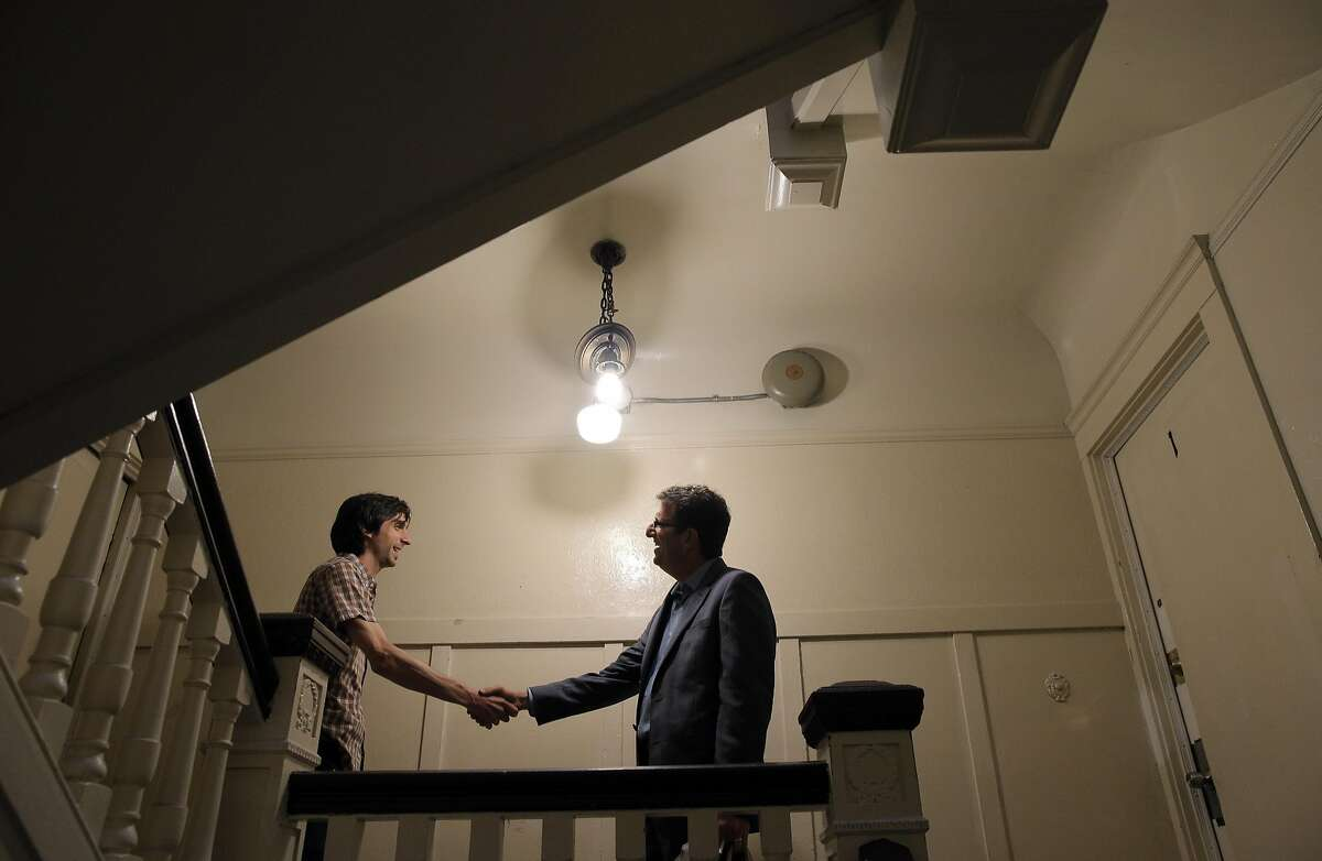 Dean Preston, candidate for the district 5 supervisor, right, shakes hands with Patrick Hackett, left, outside his apartment as Preston canvases the district on Golden Gate Avenue in San Francisco, Calif., on Tuesday, September 20, 2016.