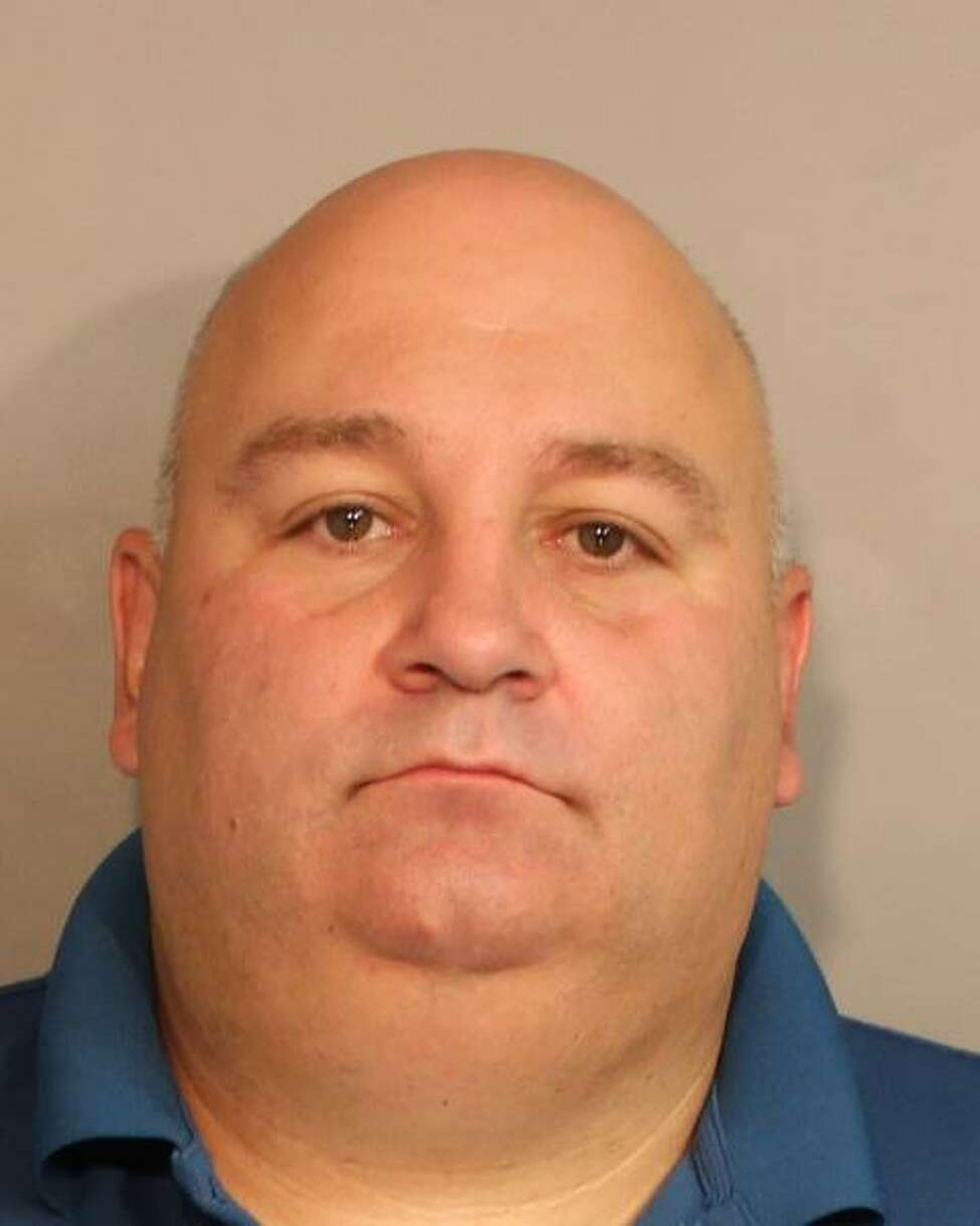 Troopers arrested Glen resident Richard A. Christiano, an off-duty Fulton County Sheriff's deputy, Tuesday for allegedly selling two handguns without the owner's permission, State Police said. Christiano is a clerk at The Gun Store in Perth. (State Police)