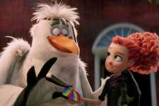 """This image released by Warner Bros. Pictures shows characters Jasper, voiced by Danny Trejo, left, and Tulip, voiced by Katie Crown in a scene from """"Storks."""" (Warner Bros. Pictures via AP)"""