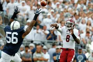 STATE COLLEGE, PA - SEPTEMBER 17:  Phillip Walker #8 of the Temple Owls passes over the arms of Tyrell Chavis #56 of the Penn State Nittany Lions during the game on September 17, 2016 at Beaver Stadium in State College, Pennsylvania.