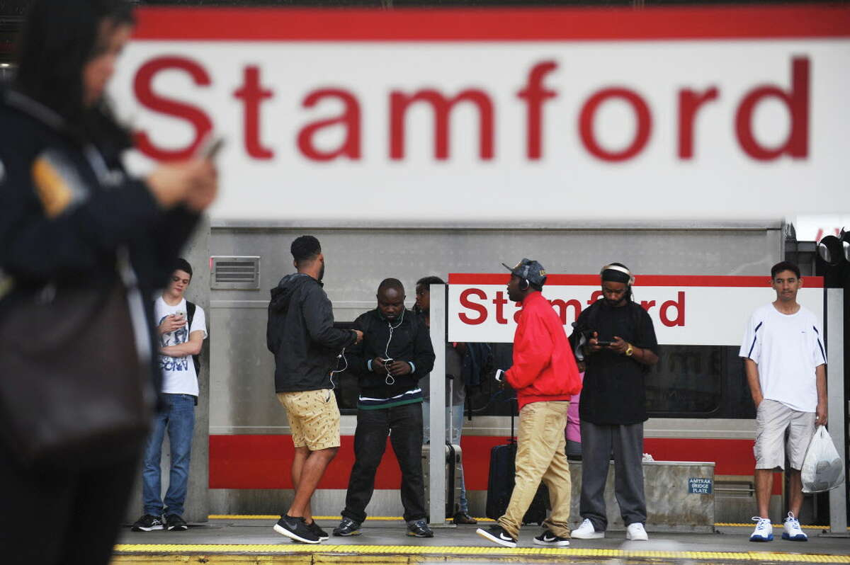 FILE - Commuters wait for the train to Grand Central Station at the Stamford train station in downtown Stamford, Conn. on Monday, September 19, 2016.