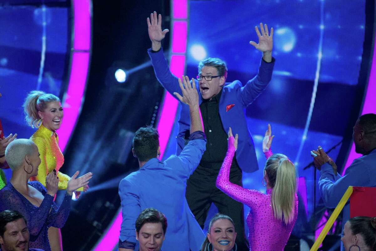 """Former Texas governor Rick Perry celebrates avoiding elimination on the Tuesday, Sept. 20, 2016 broadcast of """"Dancing with the Stars."""""""