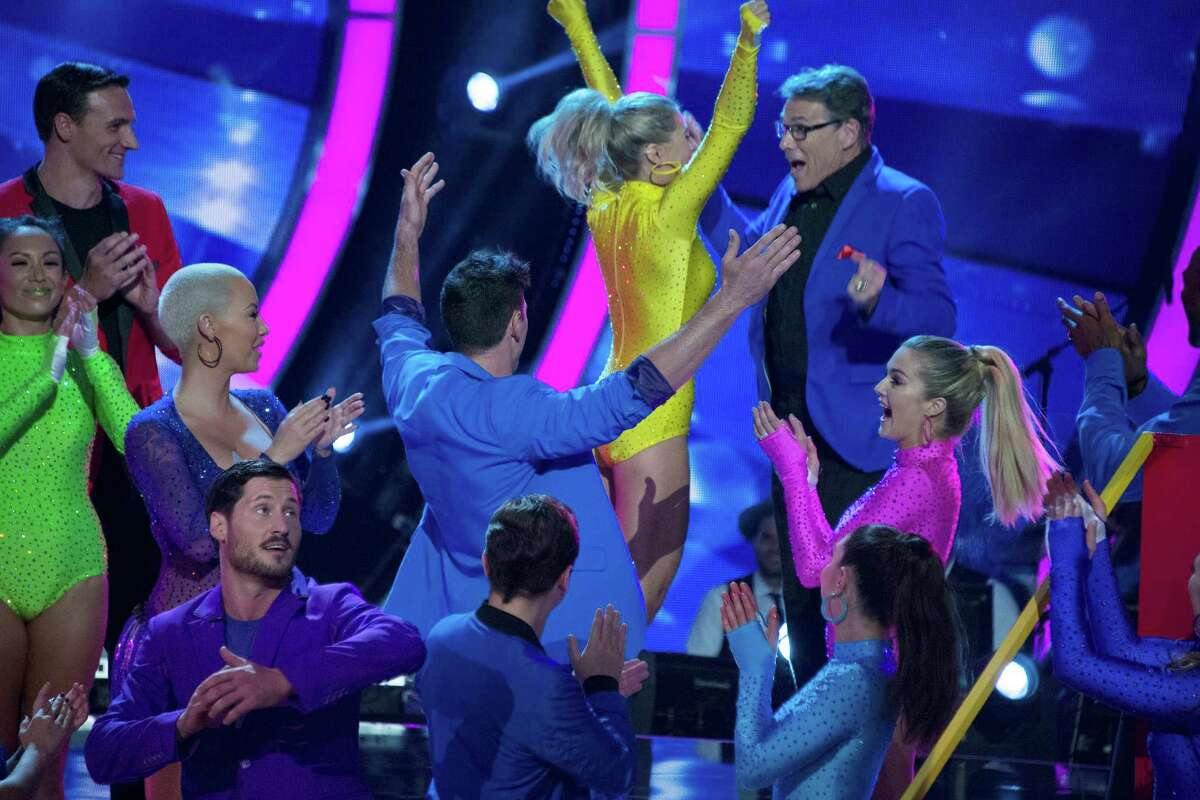 """Former Texas governor Rick Perry and dance partner Emma Slater celebrate avoiding elimination on the Tuesday, Sept. 20, 2016 broadcast of """"Dancing with the Stars."""""""