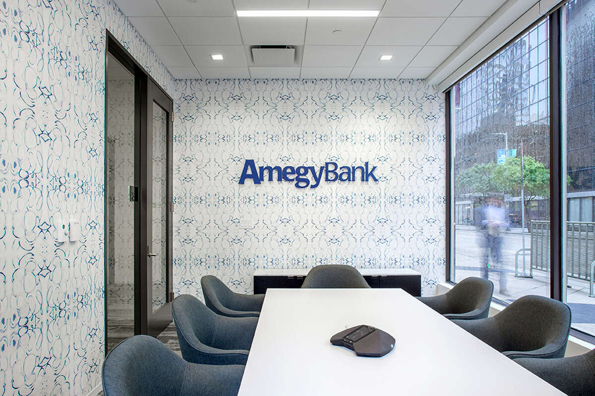 Amegy Bank opened a branch in downtown's Esperson Building at Travis and Walker. The conference room on the first floor is shown.