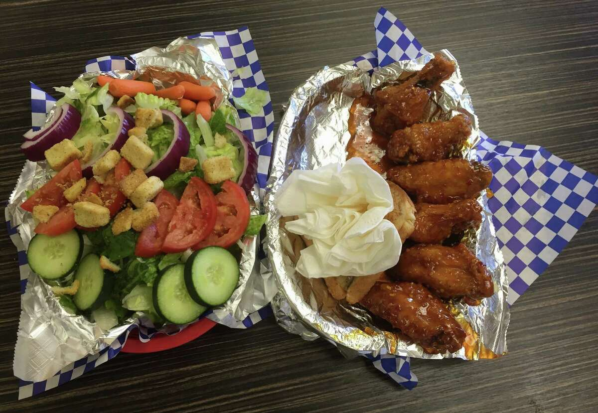 This combo features Texas Honey Bee wings and a salad. This flavor of wings features a not-too-spicy honey sauce with cayenne flakes.