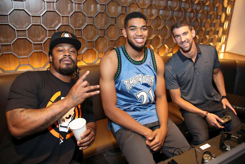 Former Seahawks running back Marshawn Lynch, NBA player Karl-Anthony Towns and Olympic swimmer Michael Phelps attend The Ultimate Fan Experience, Call Of Duty XP 2016 presented by Activision at The Forum on September 2, 2016 in Inglewood, California.