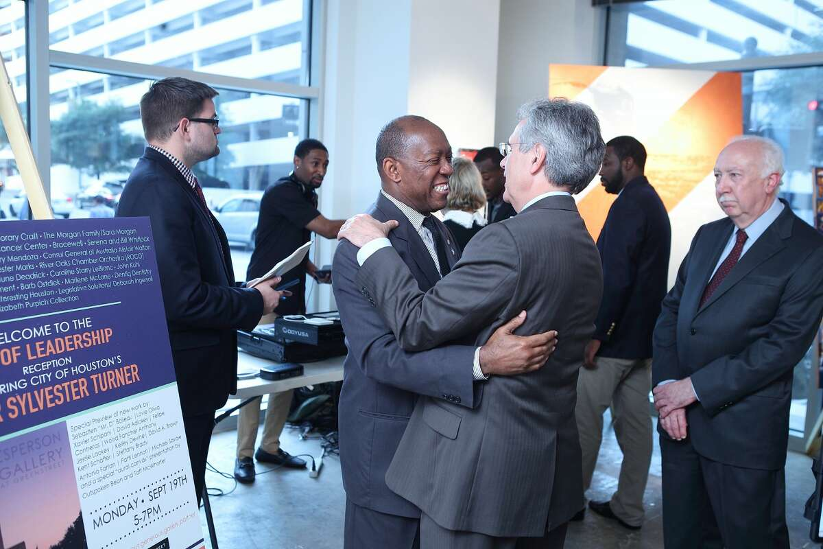 Mayor Sylvester Turner greets attendees