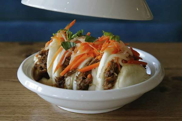 Botika at The Pearls' steamed buns, filled with pork jowl braised in hoisin sauce and shiitake mushrooms, with crisp shallots, fresh herbs and a lightly pickled slaw.