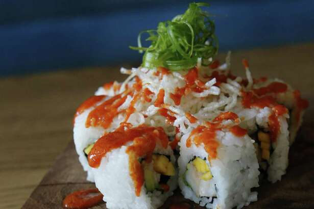 The Buenazo Roll with shrimp, avocado, mango, sesame seeds, crispy noodles and sweet aji sauce.
